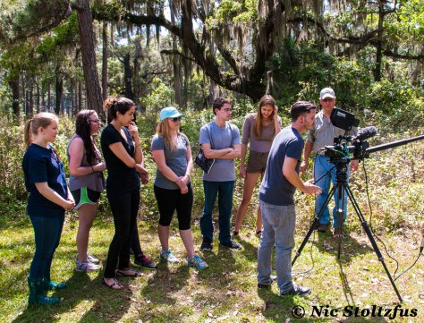 The author teaching a group of students how to film outdoors. Image by Nic Stoltzfus.
