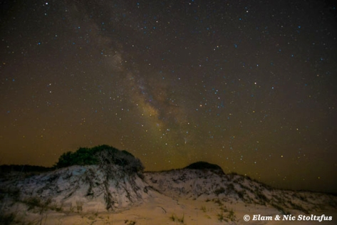 Two dunes in the foreground and the Milky Way in the background. Photo taken at Topsail Hill Preserve State Park.