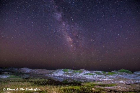 The Milky Way with a series of dunes in the foreground. Photograph taken at Topsail Hill Preserve State Park.