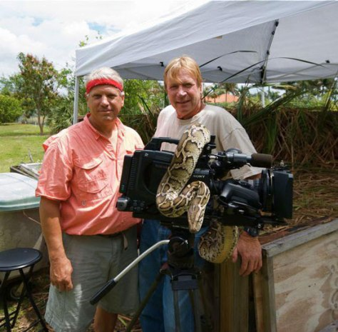 Elam with Joe Wasilewski and an invasive python in South Florida.